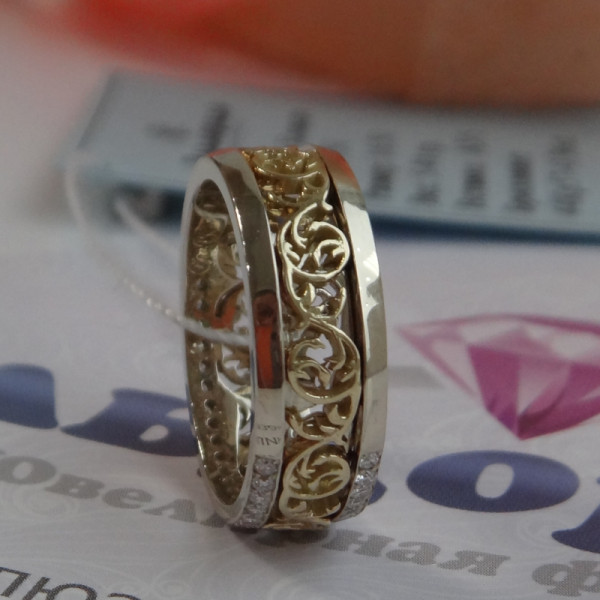 Эксклюзивное обручальное кольцо с узорами и бриллиантами