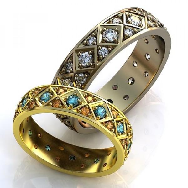 Кольцо из желтого золота с изумрудами и сапфирами