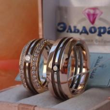 Кольцо из комбинированного золота с черным бриллиантоми