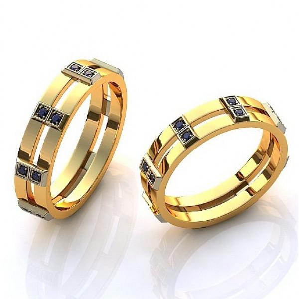 Кольцо из комбинированного золота с сапфирами
