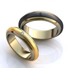 Обручальное кольцо из белого и черного золота с сапфиром