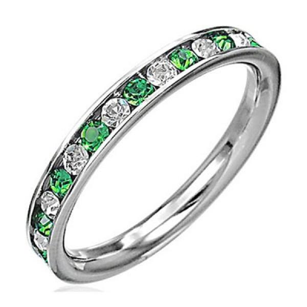 Обручальное кольцо из белого золота с бриллиантами и изумрудами