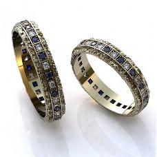 Обручальное кольцо из белого золота с бриллиантами и сапфирами
