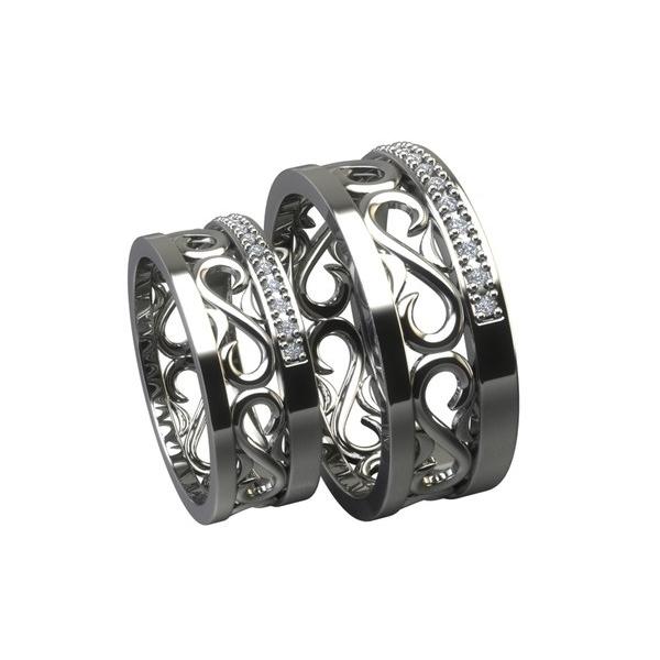 Обручальное кольцо из белого золота с узором и бриллиантами
