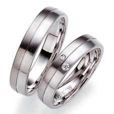 Обручальное кольцо из черного и голубого золота с бриллиантами