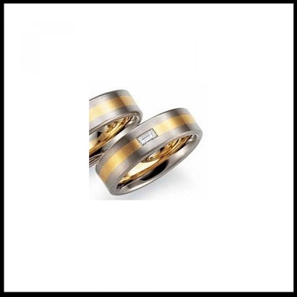 Обручальное кольцо из желтого и черного золота c бриллиантами