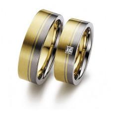 Обручальное кольцо из желтого и черного золота с алмазом