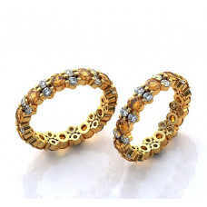Обручальное кольцо из желтого золота с бриллиантами и сапфирами