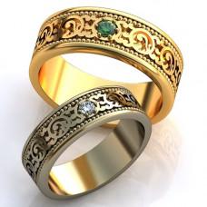 Обручальное кольцо из желтого золота с изумрудом
