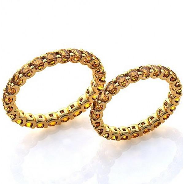 Обручальное кольцо из желтого золота с желтыми сапфирами