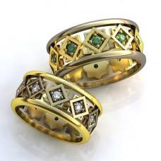 Обручальное кольцо из комбинированного с золота с изумрудами
