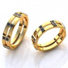 Обручальное кольцо из комбинированного золота с черными бриллиантами