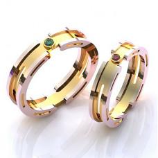 Обручальное кольцо из комбинированного золота с изумрудом