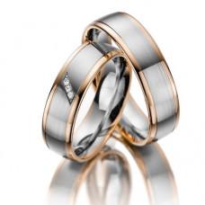 Обручальное кольцо из комбинированного золота с тремя бриллиантами