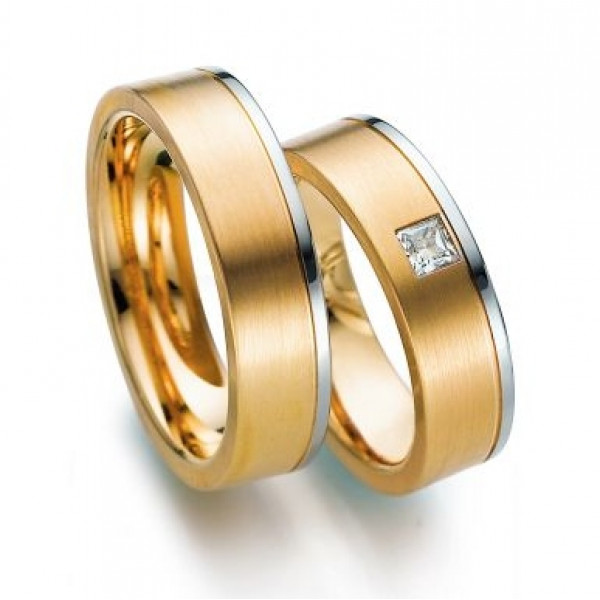 Обручальное кольцо из красного и голубого золота c алмазом