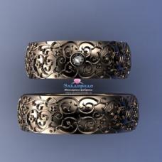 Обручальное кольцо из красного золота с бриллиантом и узором