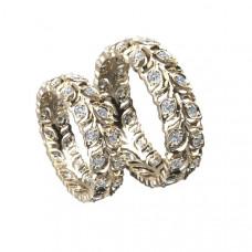 Обручальное кольцо из красного золота с узором в виде веточки с бриллиантами