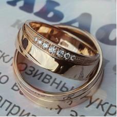 Обручальное кольцо из розового золота со спиралевидной поверхностью