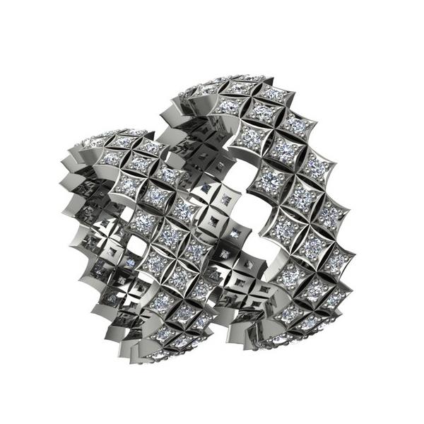 Обручальное кольцо необычной формы из белого золота с бриллиантами