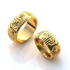Обручальное кольцо с узорами из желтого золота